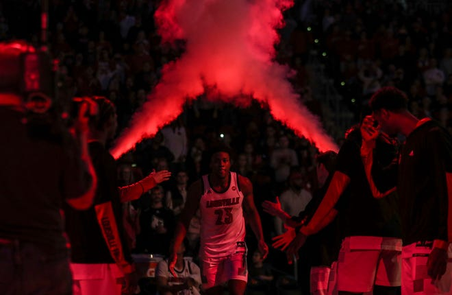 Louisville's Steven Enoch jogged out to the court during player introductions before the start of the game against Kent State. Dec. 15, 2018