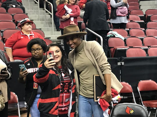 Angel McCoughtry poses with fans at the Louisville women's basketball 2009 Final Four ceremony. Dec. 15, 2018