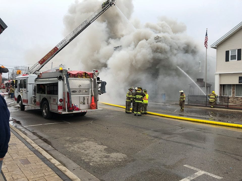 Fire crews battle a structure fire in downtown Fowler on Saturday.