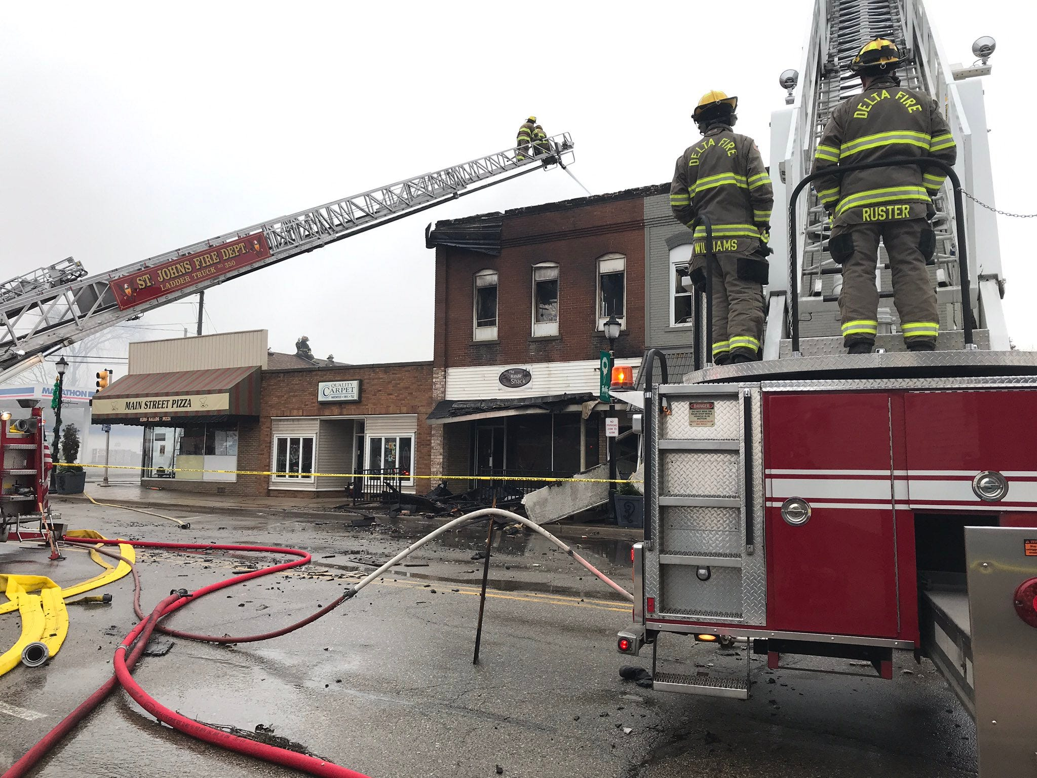 Fire departments responding to structure fire in downtown Fowler.