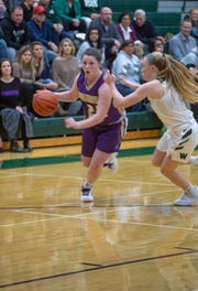 Fowlerville's Jackie Jarvis, who had a team-high 10 points, droves toward the lane in a 39-34 loss at Williamston on Friday, Dec. 14, 2018.