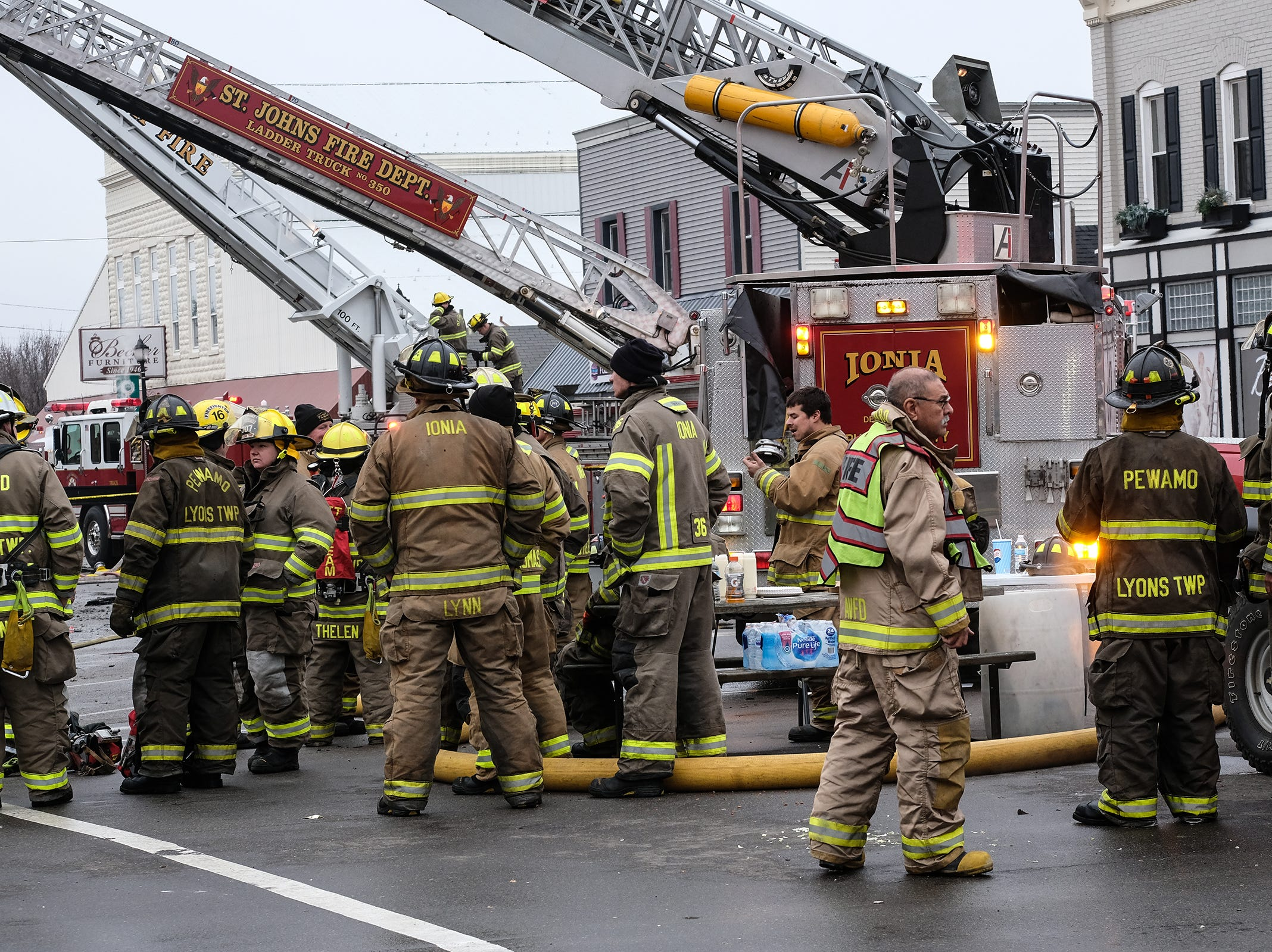 Firefighters from several municipalities work to extinguish a fire in downtown Fowler Saturday, Dec. 15, 2018.