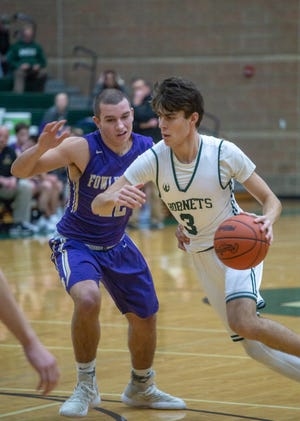 Williamston's Case Conley drives to the basket during a contest against Fowlerville on Friday, Dec. 14, 2018.