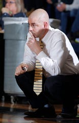 DeWitt coach Bill Flannery watches against East Lansing, Friday, Dec. 14, 2018, in East Lansing, Mich.