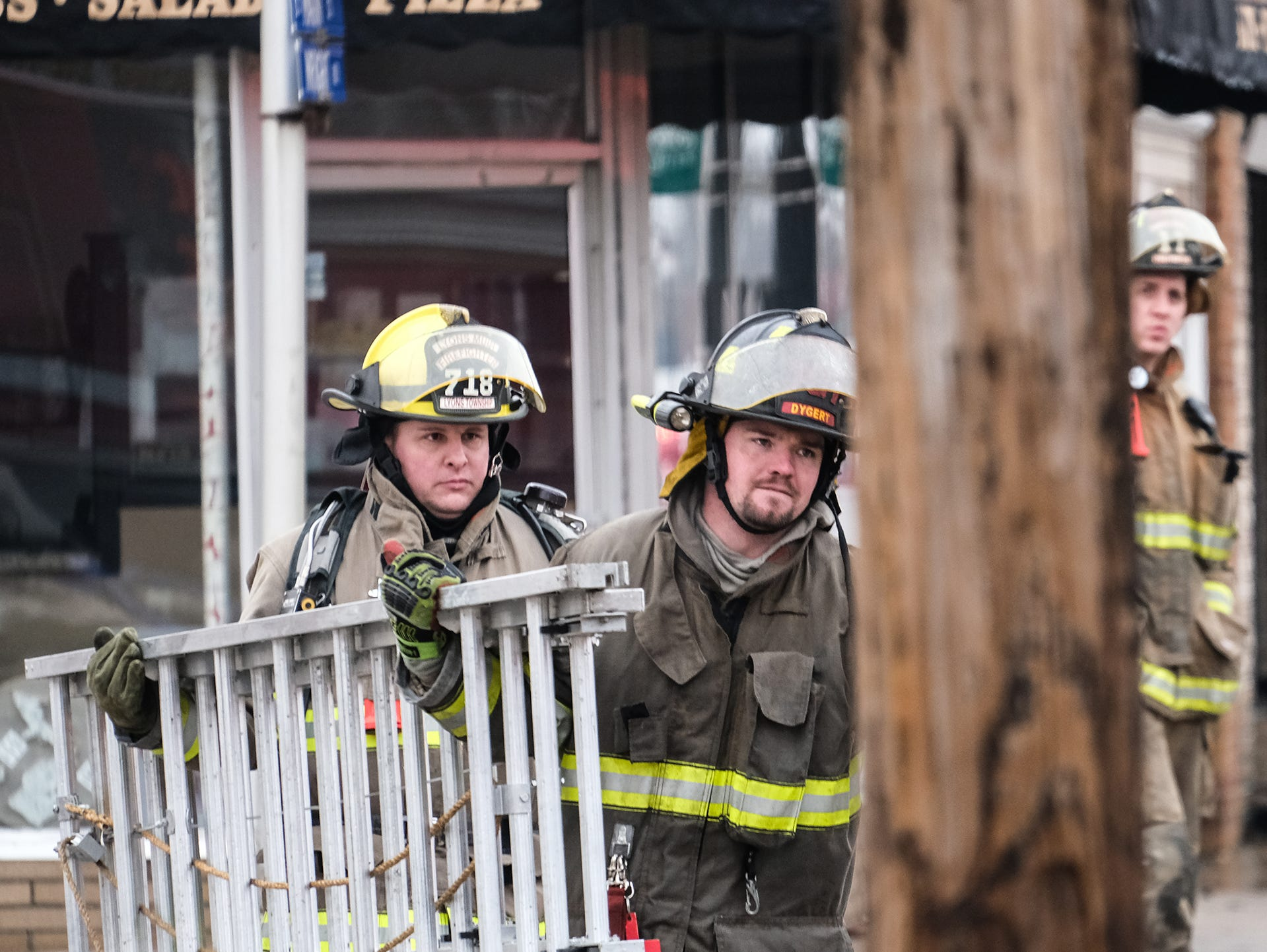 Firefighters are at work in Fowler to extinguish a fire in the downtown area Saturday, Dec. 15, 2018.