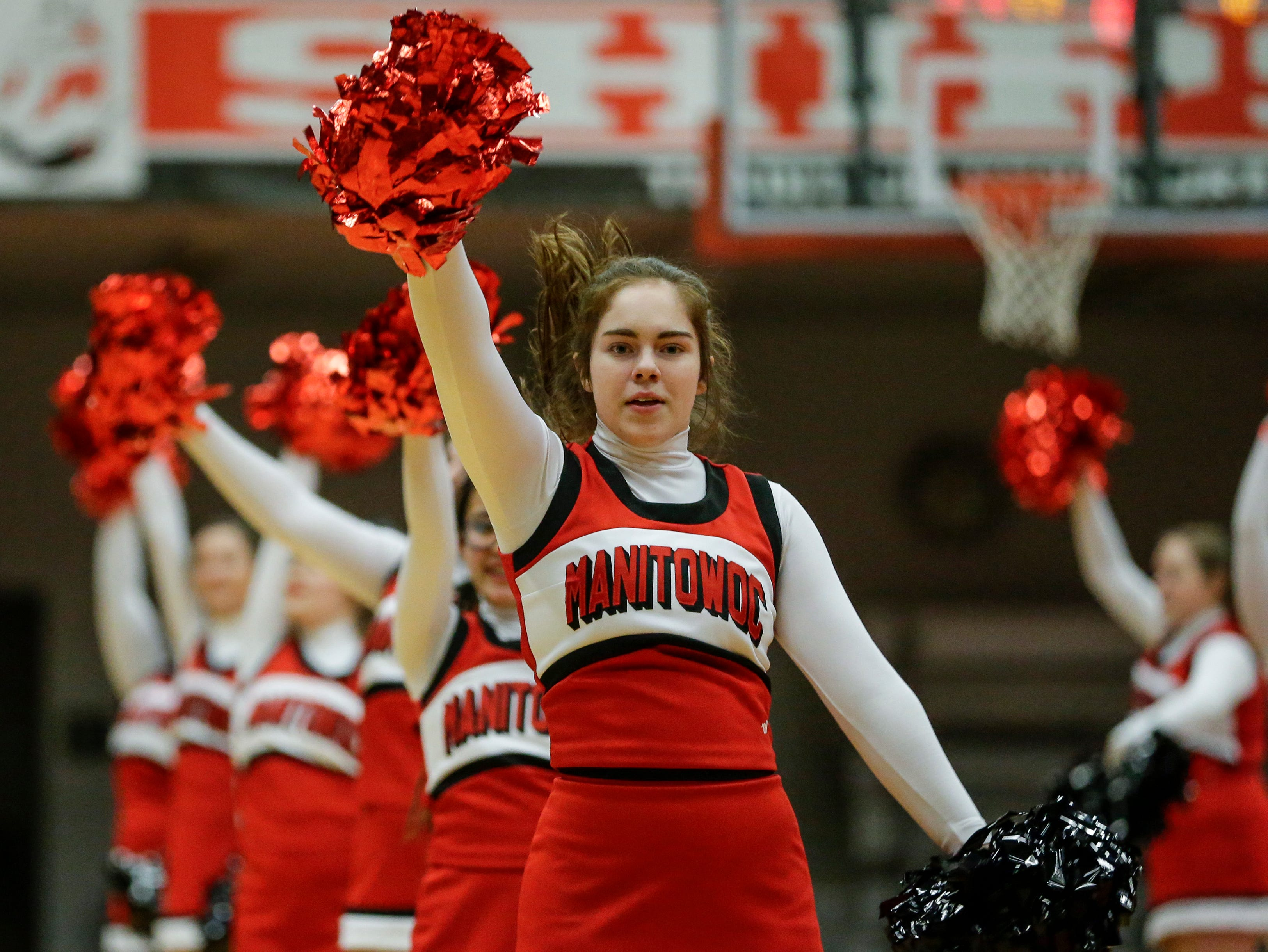Manitowoc Lincoln's cheer team performs at halftime at Manitowoc Lincoln High School Friday, December 14, 2018, in Manitowoc, Wis. Joshua Clark/USA TODAY NETWORK-Wisconsin