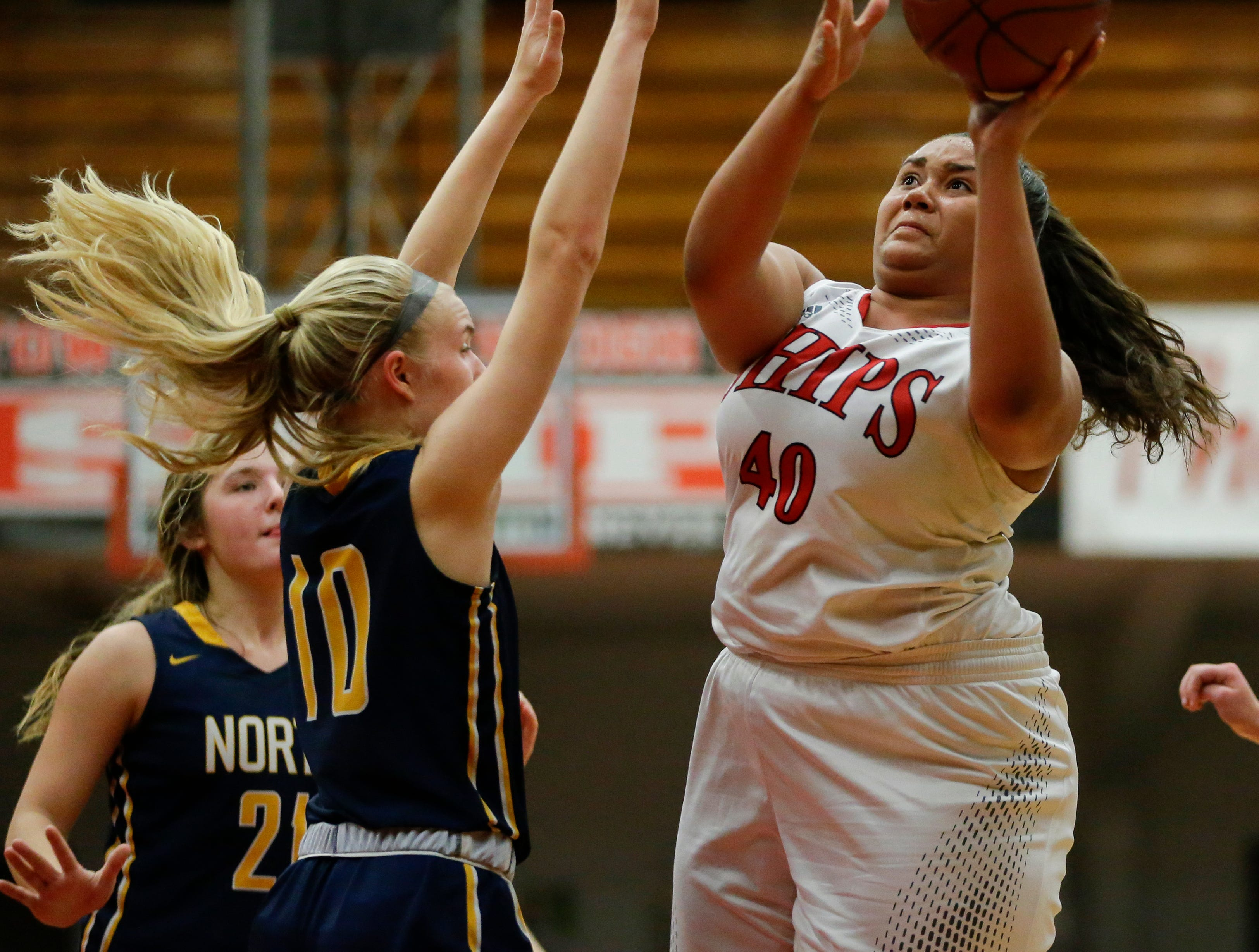 Manitowoc Lincoln's Massendra Musial shoots over Sheboygan North's Sydney Vogel during a Fox River Classic Conference game at Manitowoc Lincoln High School Friday, December 14, 2018, in Manitowoc, Wis. Joshua Clark/USA TODAY NETWORK-Wisconsin
