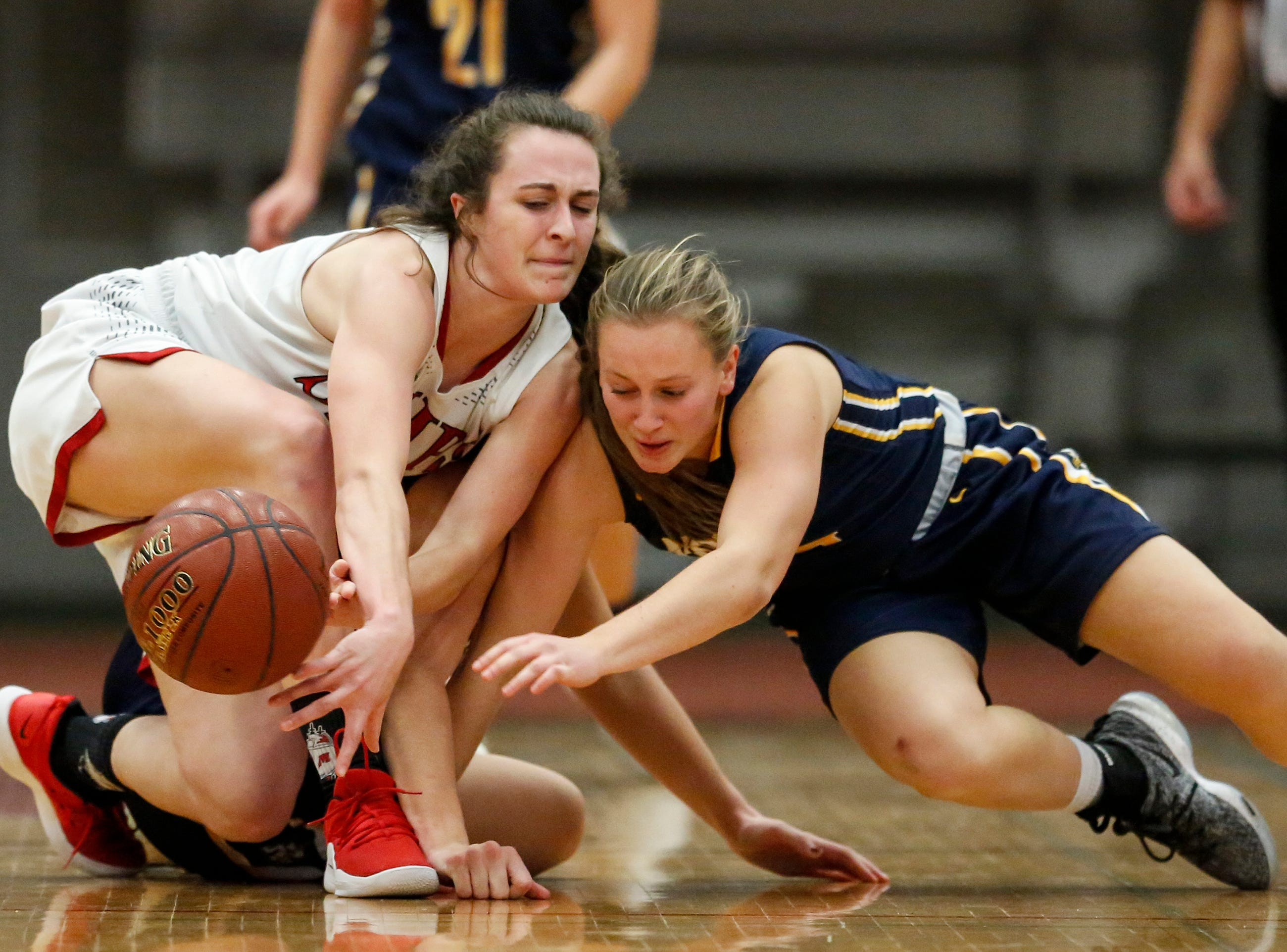 Manitowoc Lincoln's Ava Swoboda battles Sheboygan North's Julia Scharinger for a loose ball during a Fox River Classic Conference game at Manitowoc Lincoln High School Friday, December 14, 2018, in Manitowoc, Wis. Joshua Clark/USA TODAY NETWORK-Wisconsin