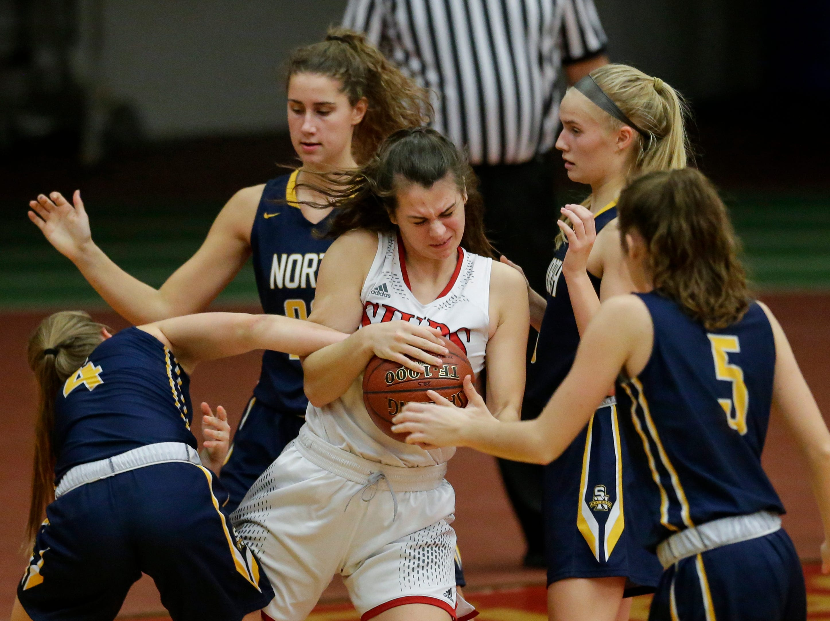 Manitowoc Lincoln's Claire Swoboda struggles to keep possession of the ball against Sheboygan North during a Fox River Classic Conference game at Manitowoc Lincoln High School Friday, December 14, 2018, in Manitowoc, Wis. Joshua Clark/USA TODAY NETWORK-Wisconsin