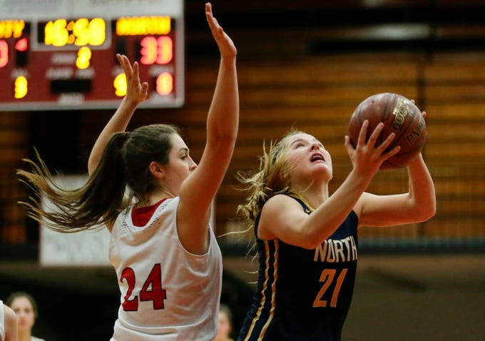 Sheboygan North's Emma Belmore puts up a shot against Manitowoc Lincoln during a Fox River Classic Conference game at Manitowoc Lincoln High School Friday, December 14, 2018, in Manitowoc, Wis. Joshua Clark/USA TODAY NETWORK-Wisconsin