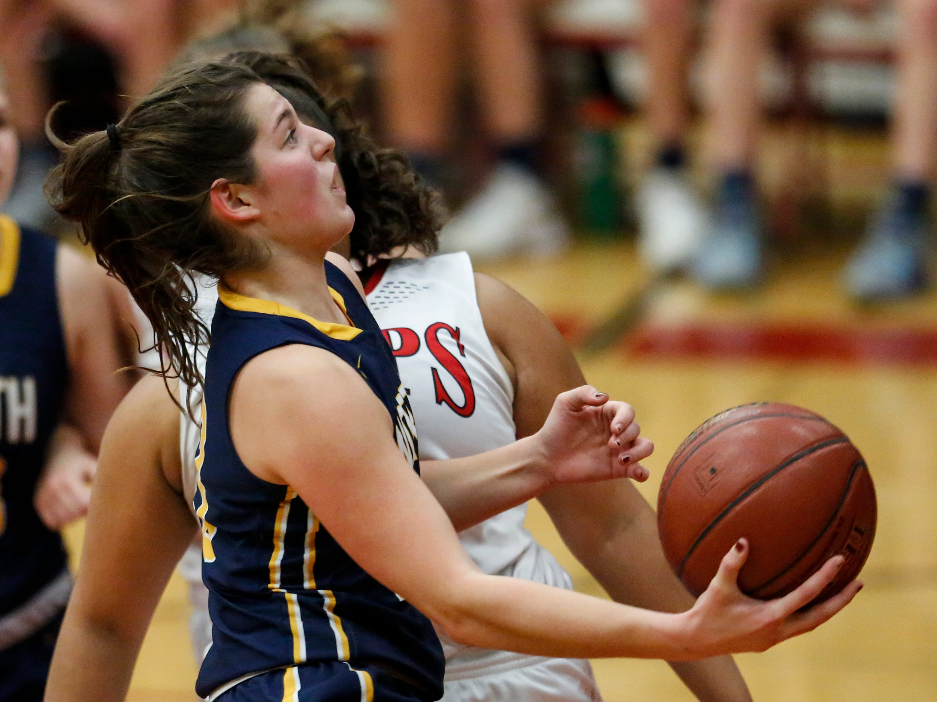 Sheboygan North's Meredith Opie drives to the hoop against Manitowoc Lincoln during a Fox River Classic Conference game at Manitowoc Lincoln High School Friday, December 14, 2018, in Manitowoc, Wis. Joshua Clark/USA TODAY NETWORK-Wisconsin