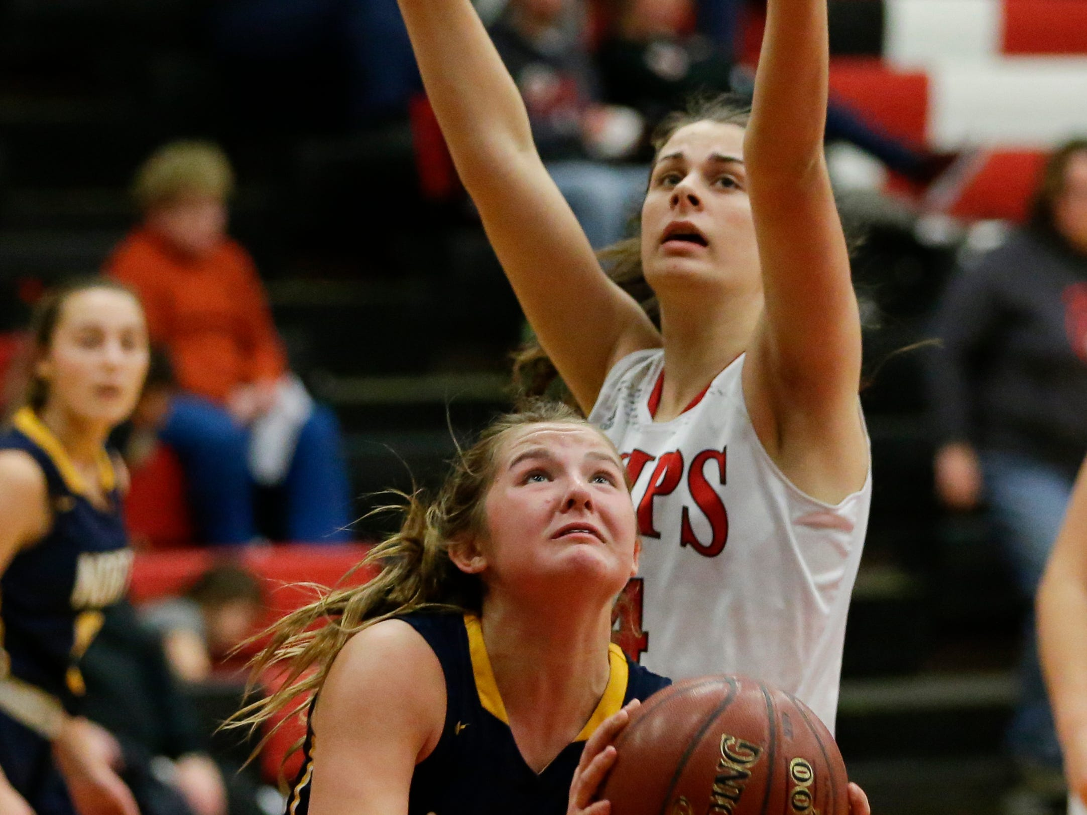 Sheboygan North's Emma Belmore goes under Manitowoc Lincoln's Claire Swoboda for a shot during a Fox River Classic Conference game at Manitowoc Lincoln High School Friday, December 14, 2018, in Manitowoc, Wis. Joshua Clark/USA TODAY NETWORK-Wisconsin