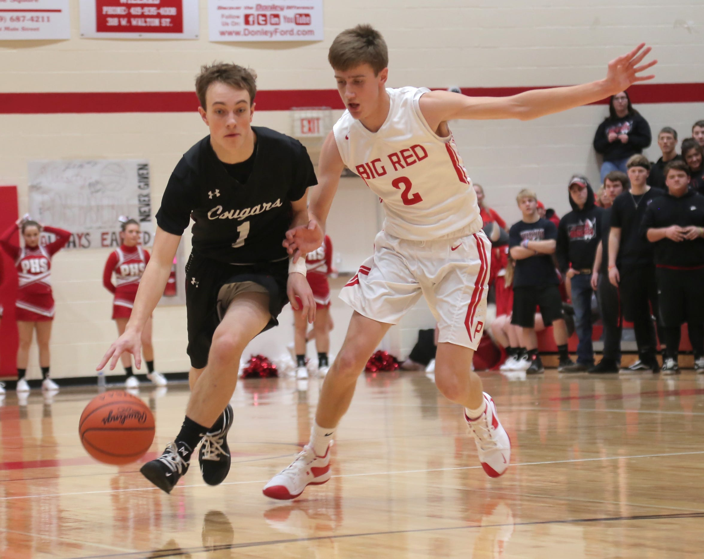 Crestview's Jacob Greer dribbles against Plymouth's Jacob Adams during the 2018-19 season.