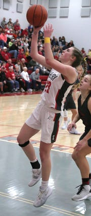 Shelby's Olivia Baker attempts a jump shot while playing against Marion Harding earlier this season.