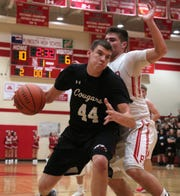 Crestview's Nick Ritchey moves the ball down the court while playing at Plymouth earlier in the season.