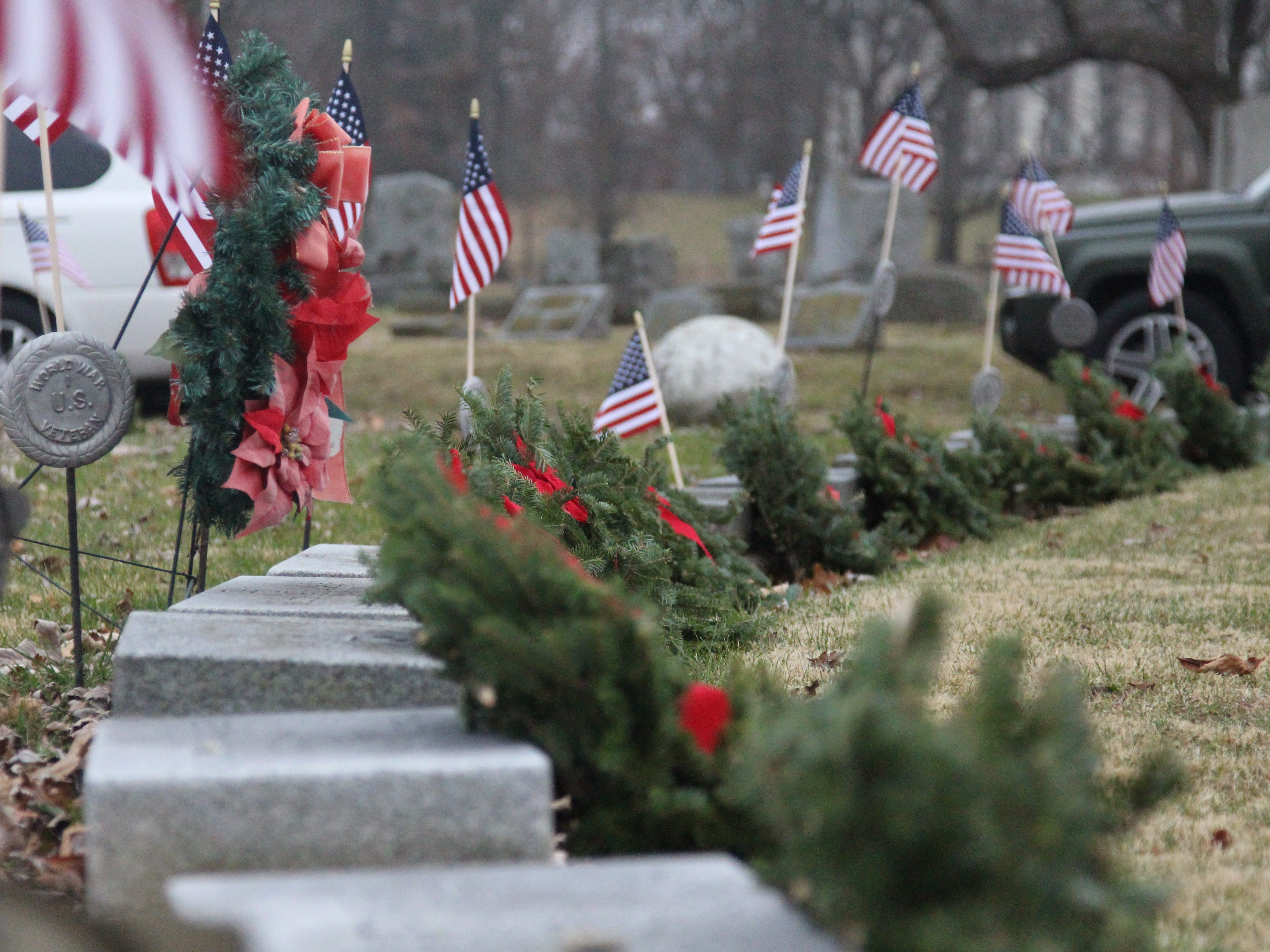 Wreaths lay on the graves of veterans Saturday in Marion Cemetery. Boy Scout Troop 46 in Marion was among the volunteers to place the wreaths on their graves as part of Wreaths Across America, a nationwide effort to honor veterans during the holiday season.