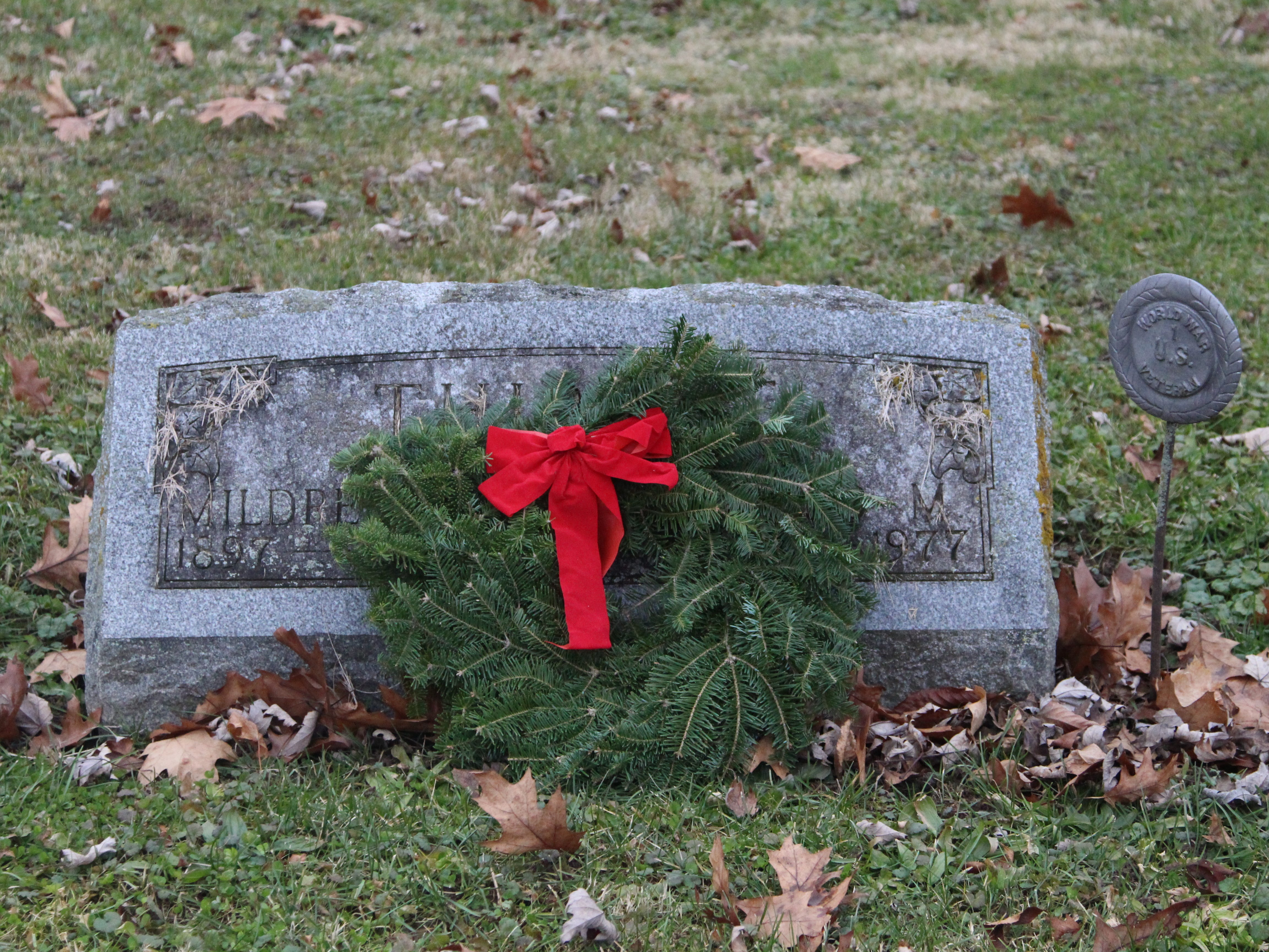 A donated wreath lays on the grave of a veteran Saturday at Marion Cemetery.