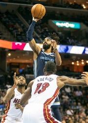 Memphis Grizzlies guard Mike Conley (11) shots during the first half of a regular season NBA basketball game between the Memphis Grizzlies and the Miami Heat, Friday, Dec. 14, 2018