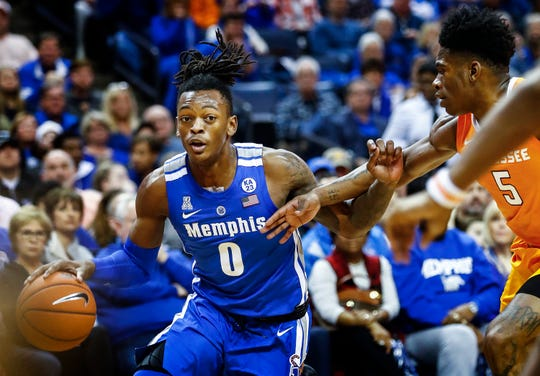 Memphis forward Kyvon Davenport (left) drives the lane against Tennessee during action at the FedExForum, Saturday, December 15, 2018.