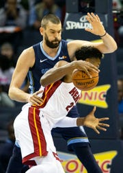 Memphis Grizzles center Marc Gasol (33), guards Miami Heat center Hassan Whiteside (21), during the first half of  a NBA basketball game between the Memphis Grizzlies and the Miami Heat in the Fedex Forum, Friday, Dec. 14, 2018.