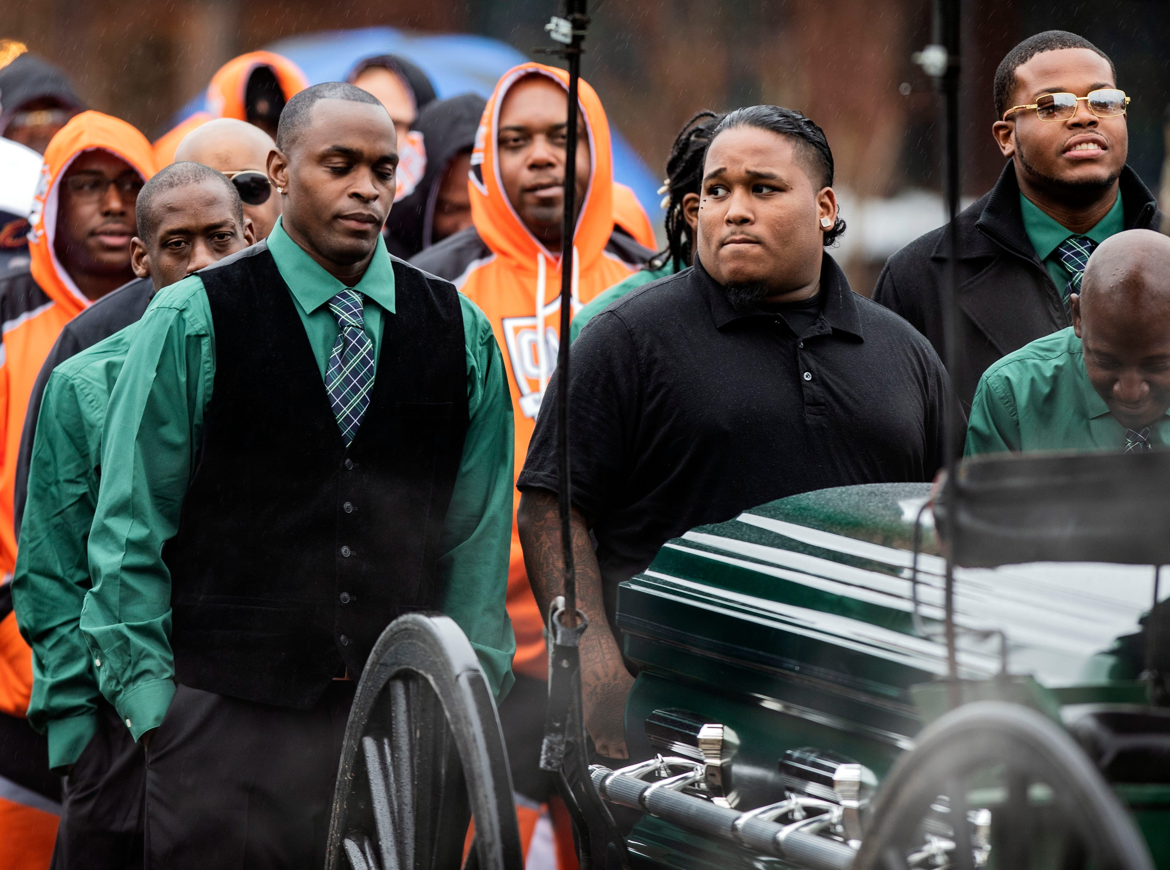 Wolfpack and Orange Mound Youth Association coaches walk behind a carriage carrying Kameren Johnson's casket before he is laid to rest, Saturday, Dec. 15, 2018.