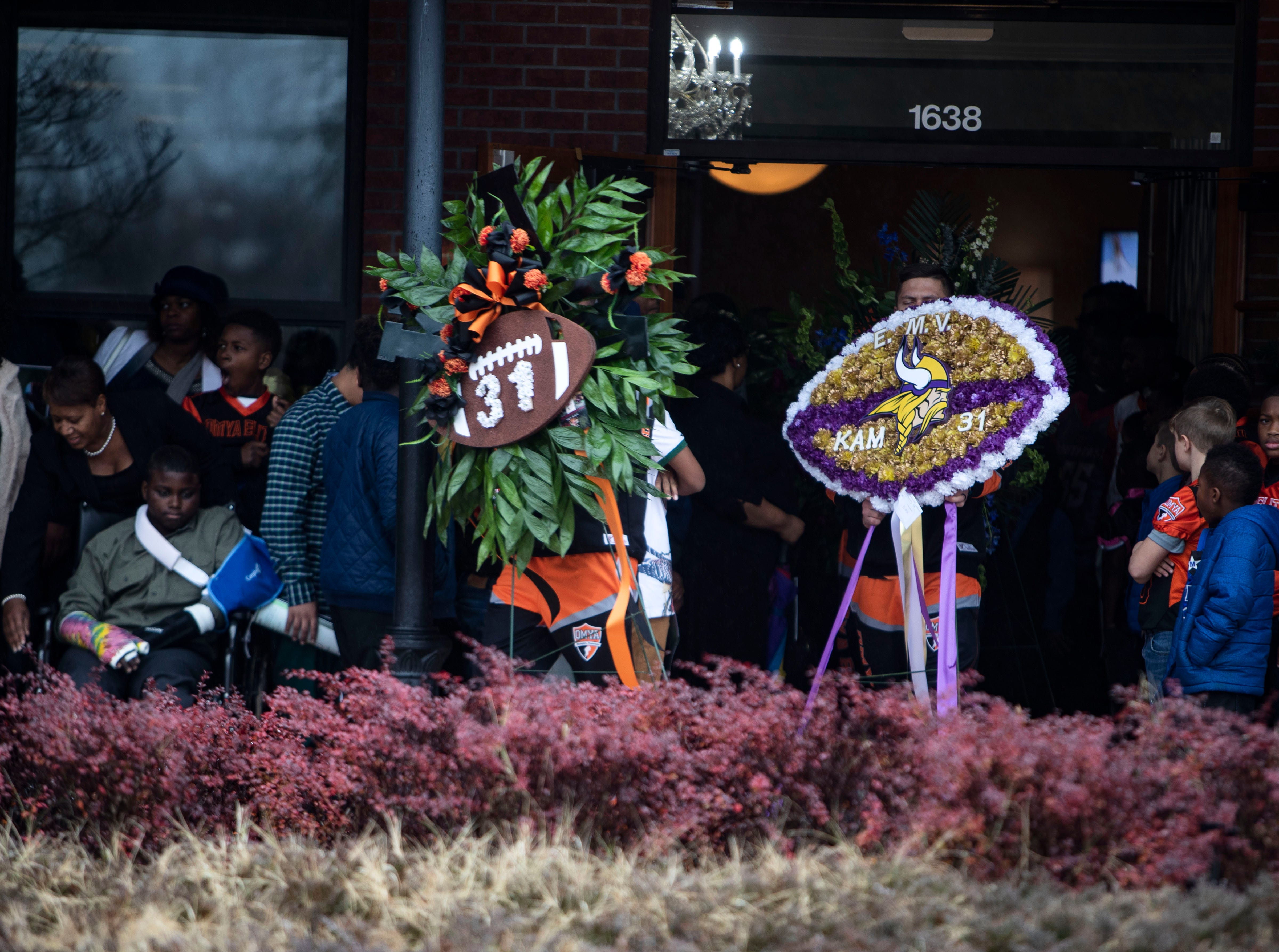 Orange Mound Youth Association coaches carry reefs to the burial site, during  9-year-old Kameren Johnson's funeral, Saturday, Dec. 15, 2018.