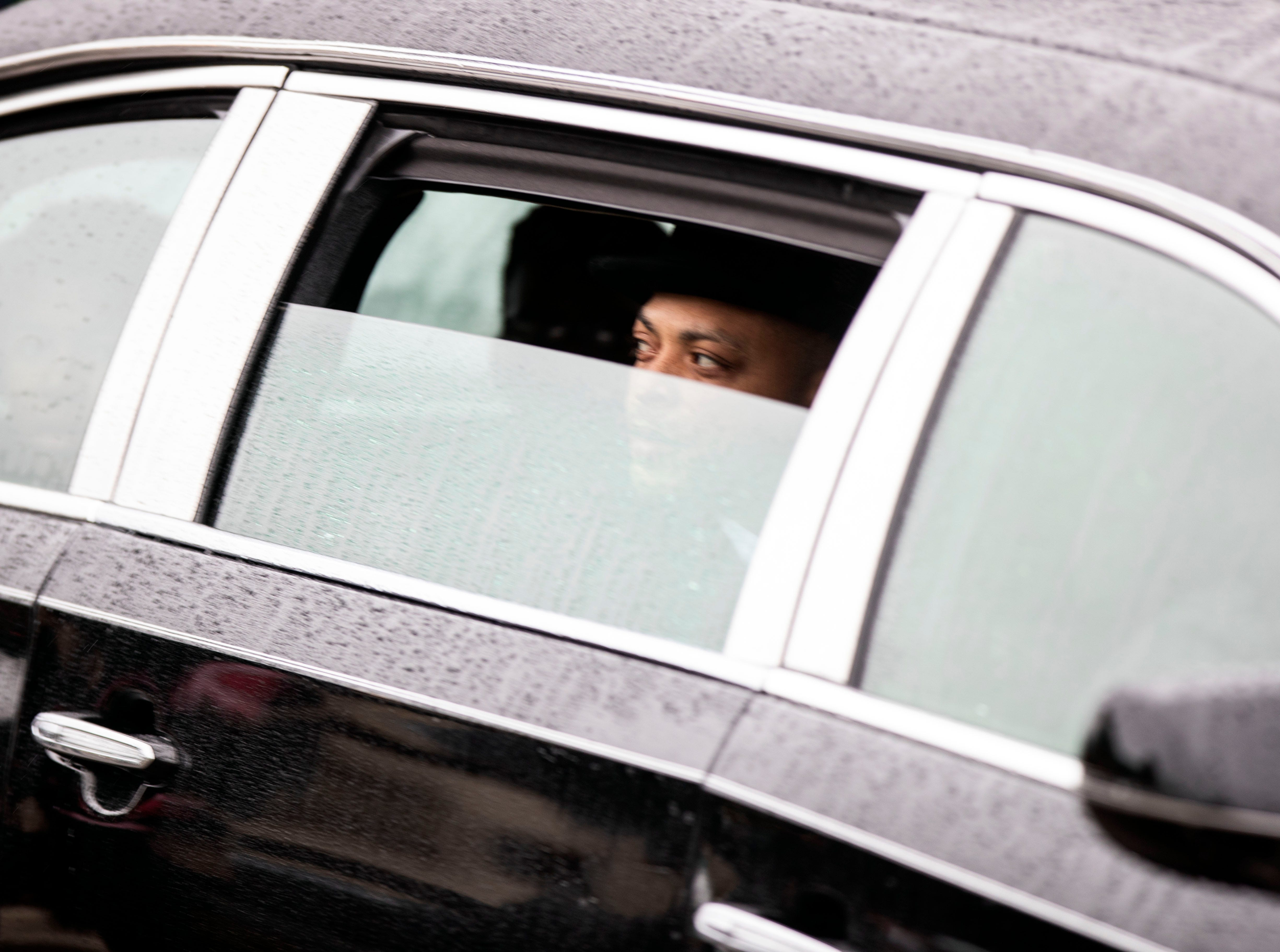 A member of Kameren Johnson's family looks out the widow as they drive to the burial site, Saturday, Dec. 15, 2018.