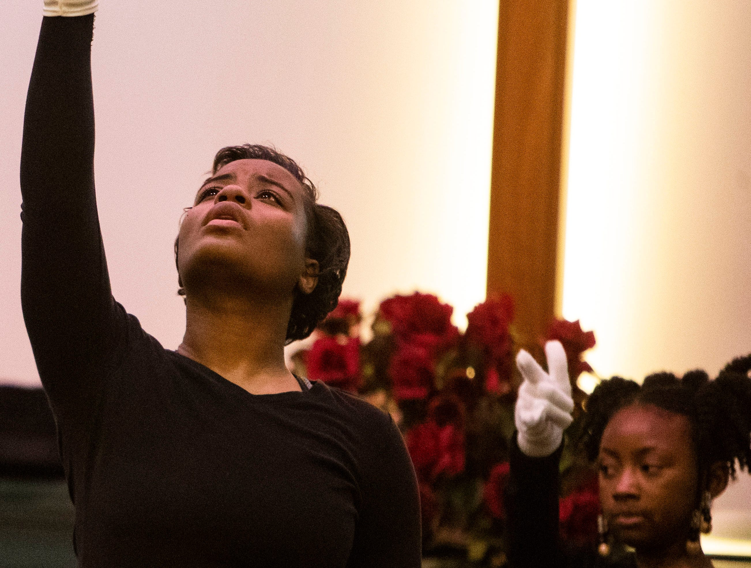 Wolfpack Dancers perform a praise dance during 9-year-old Kameren Johnson's funeral, Saturday, Dec. 15, 2018.