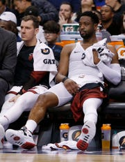 Miami Heat guard Dwyane Wade (3) sits on the bench during the second half of the team's NBA basketball game against the Phoenix Suns on Dec. 7 in Phoenix. The Heat won 115-98.