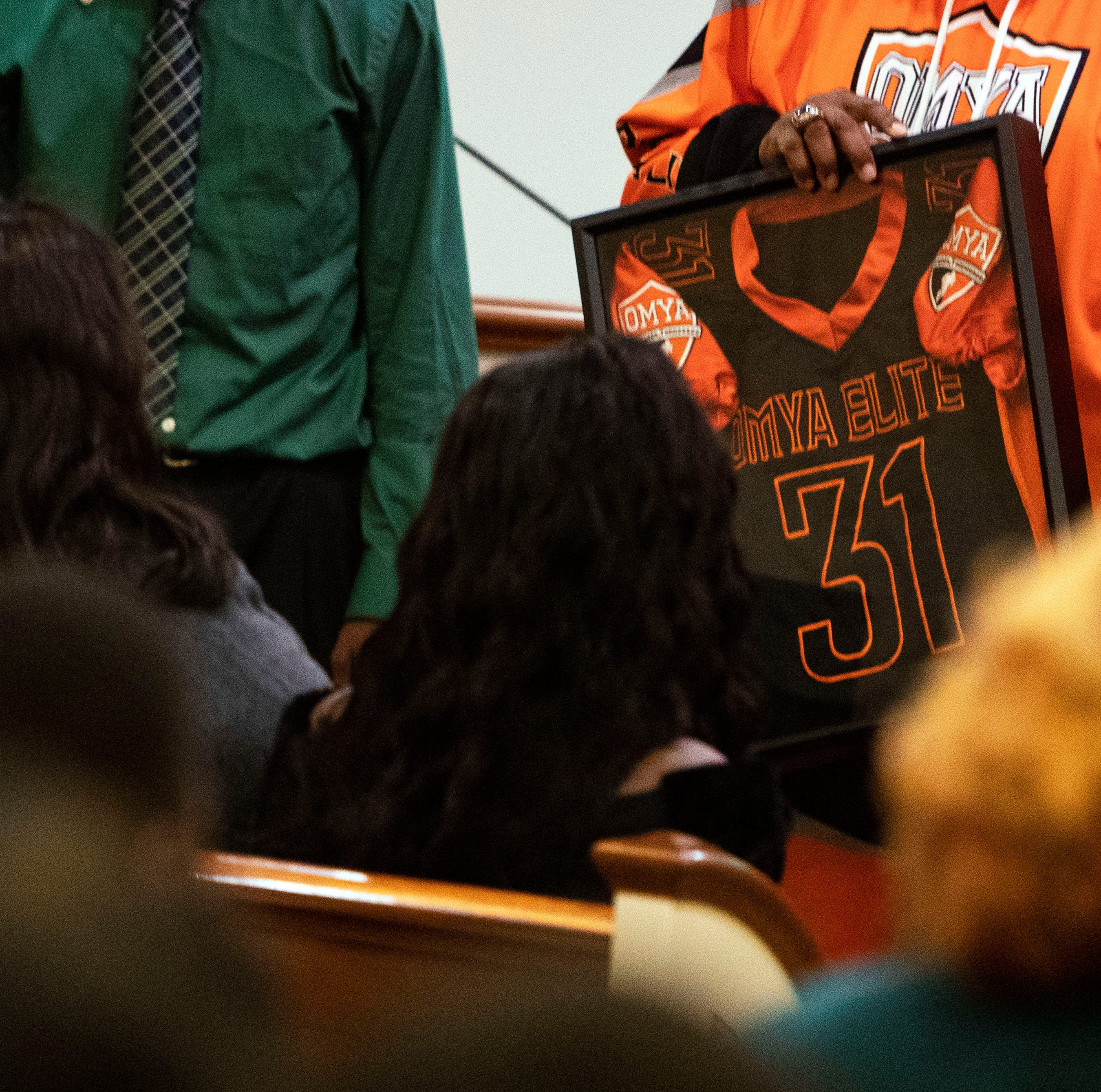 Kameron Johnson's parents presented with football jersey he wore before deadly bus crash