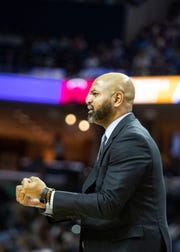 Memphis Grizzles head coach J.B. Bickerstaff yells during the first half of the a NBA basketball game between the Memphis Grizzlies and the Miami Heat in the Fedex Forum, Friday, Dec. 14, 2018.