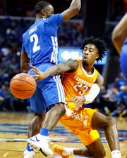 Tennessee guard Jordan Bowden (right) makes a pass around Memphis defender Alex Lomax (left) during action at the FedExForum, Saturday, December 15, 2018.