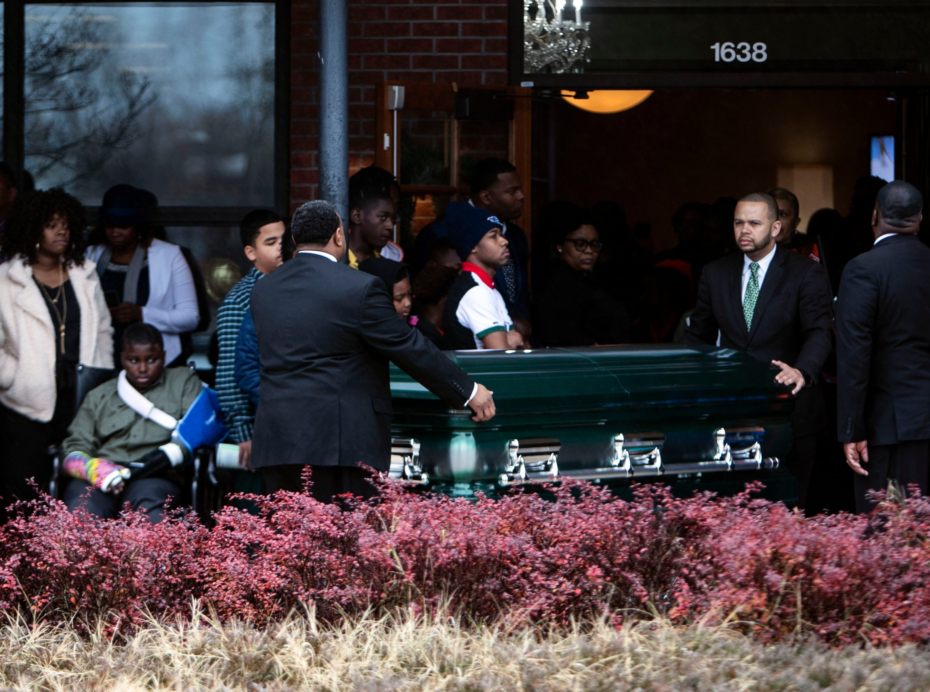 Kameren Johnson's casket is carried out of the Serenity Funeral Home's, Saturday, Dec. 15, 2018.