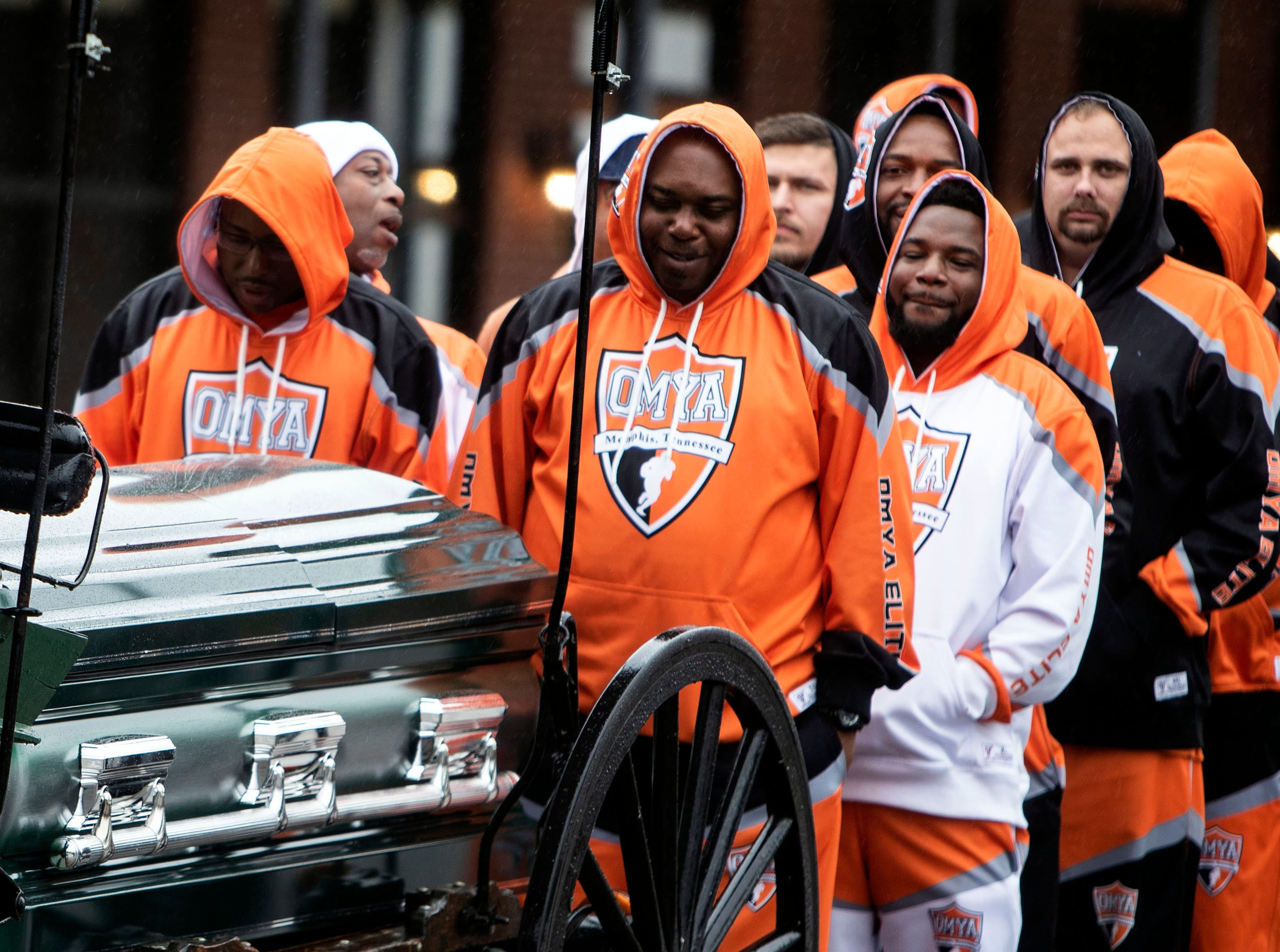 Orange Mound Youth Association coaches place Kameren Johnson's casket on the back of a carriage during the funeral, Saturday, Dec. 15, 2018.