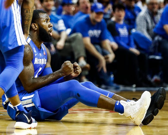 Memphis senior Raynere Thornton wears one black and one white shoe to symbolize his family and the various people who helped raise him.