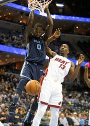 Memphis Grizzles forward JaMychal Green (0), dunks over Miami Heat forward Bam Adebayo (13),  during the first half of  a NBA basketball game between the Memphis Grizzlies and the Miami Heat in the Fedex Forum, Friday, Dec. 14, 2018.