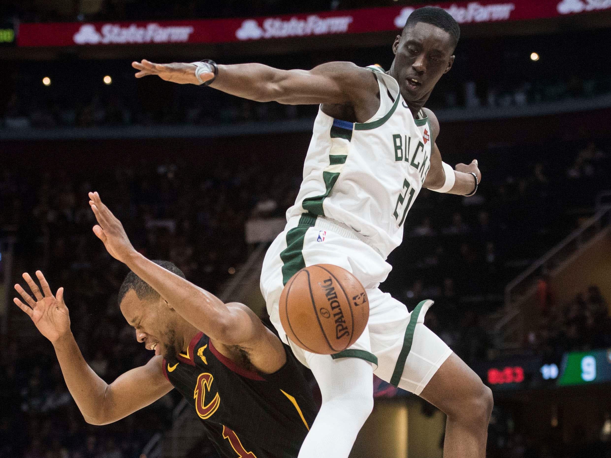 Bucks guard Tony Snell fouls Cleveland Cavaliers guard Rodney Hood.