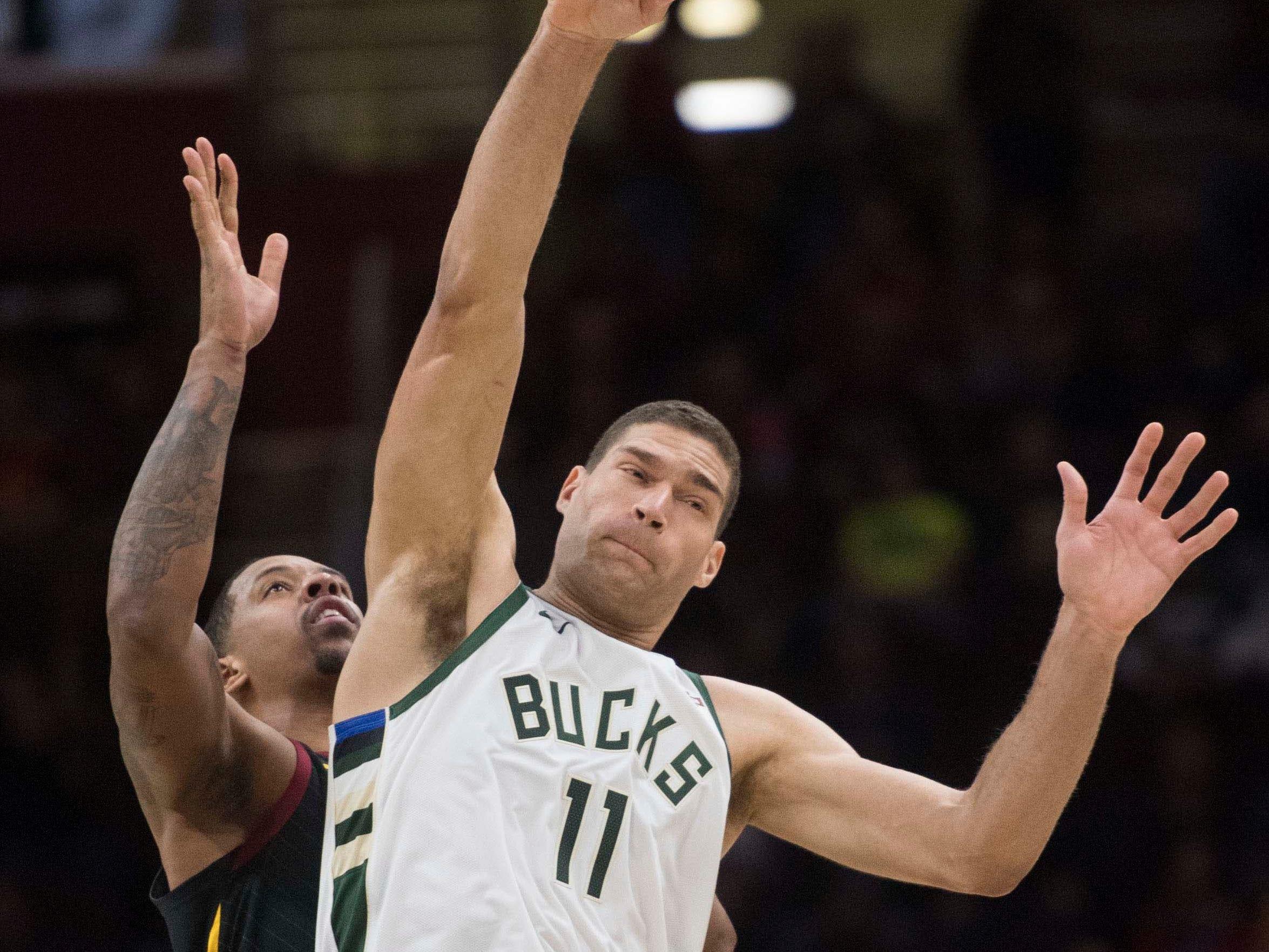 Bucks center Brook Lopez  controls the opening tip.