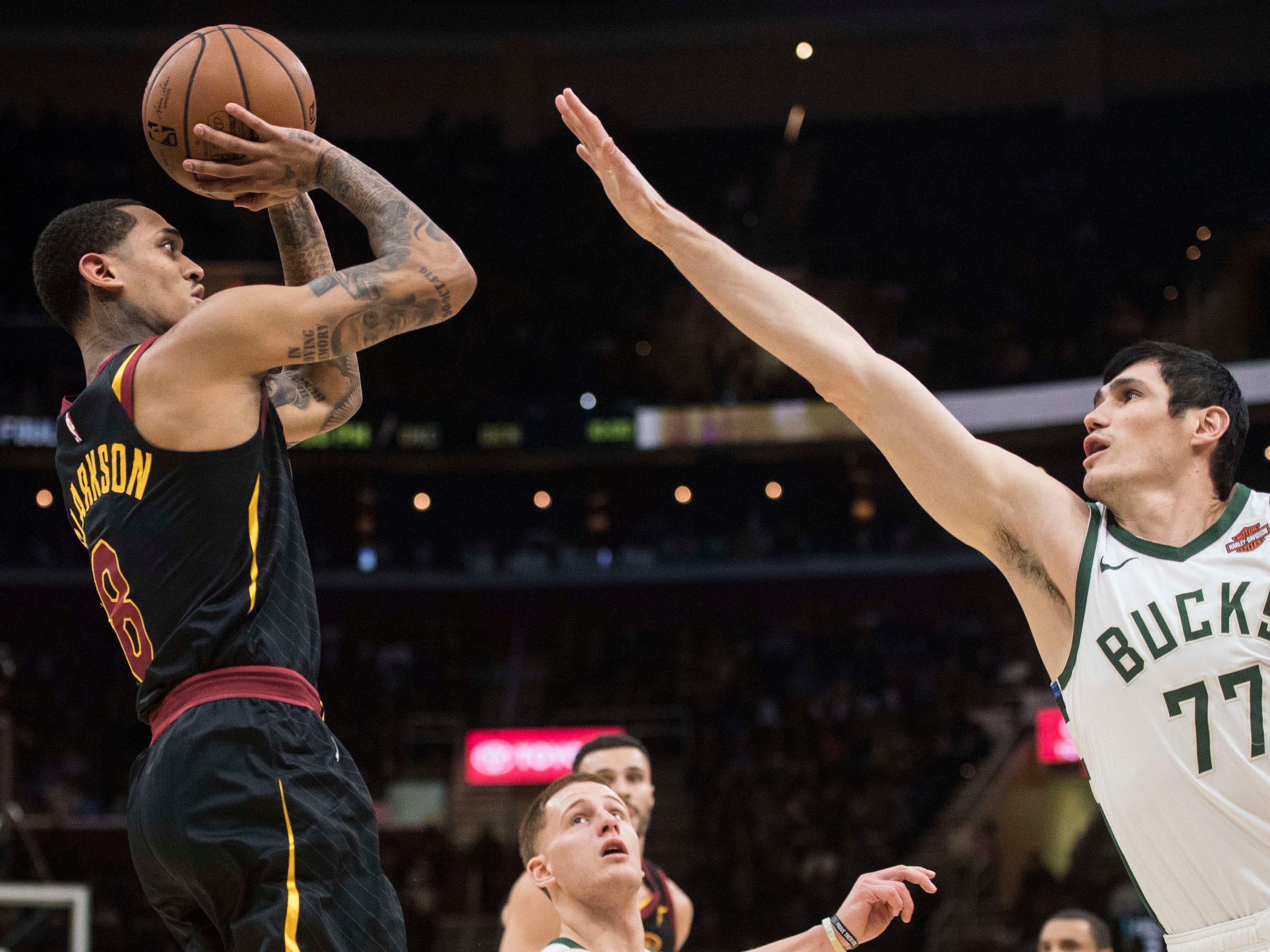 Cavaliers guard Jordan Clarkson shoots over  Bucks forward Ersan Ilyasova.
