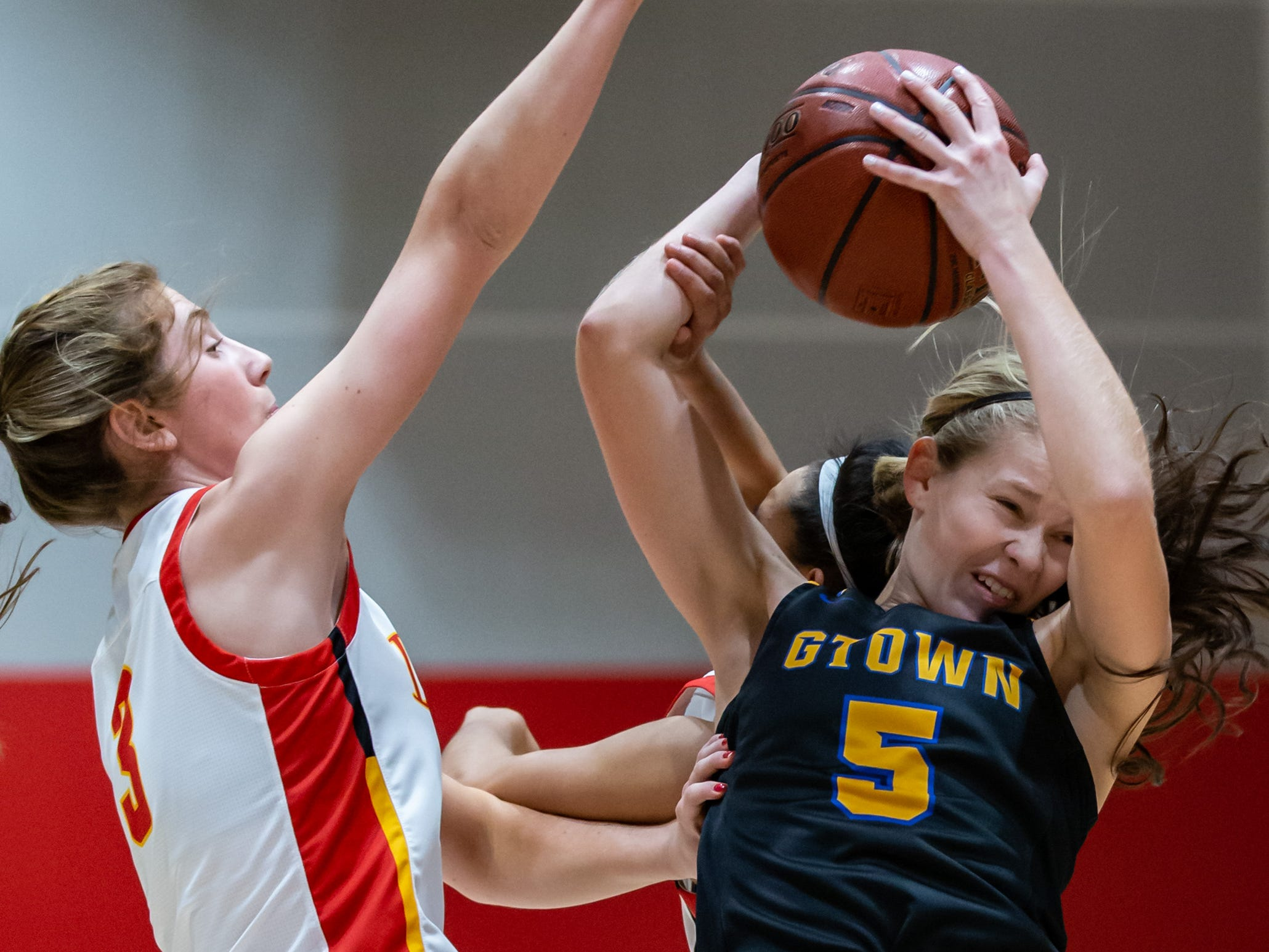 Germantown senior McKenna Klopfer (5) pulls down a rebound during the game at Divine Savior Holy Angels on Friday, Dec. 14, 2018.