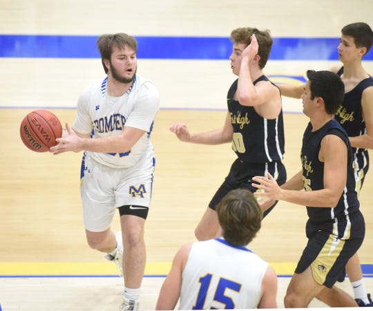 Mountain Home's Mat Jones looks for an open teammate as three Bentonville West defenders arrive Friday night at The Hangar.