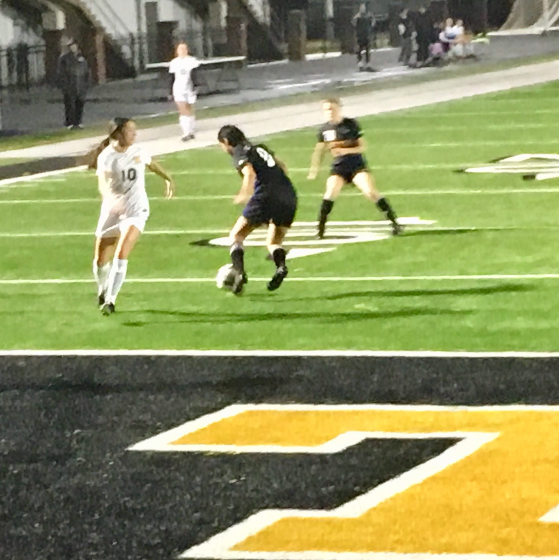 Benton defenders Lexy Ybarra (8) and Bailey Coleman (3) converge on Neville forward Caroline Hebert late in the second half of Neville's 2-0 win in the 2018 Vacanza Classico at Neville's Bill Ruple Stadium on Friday evening.