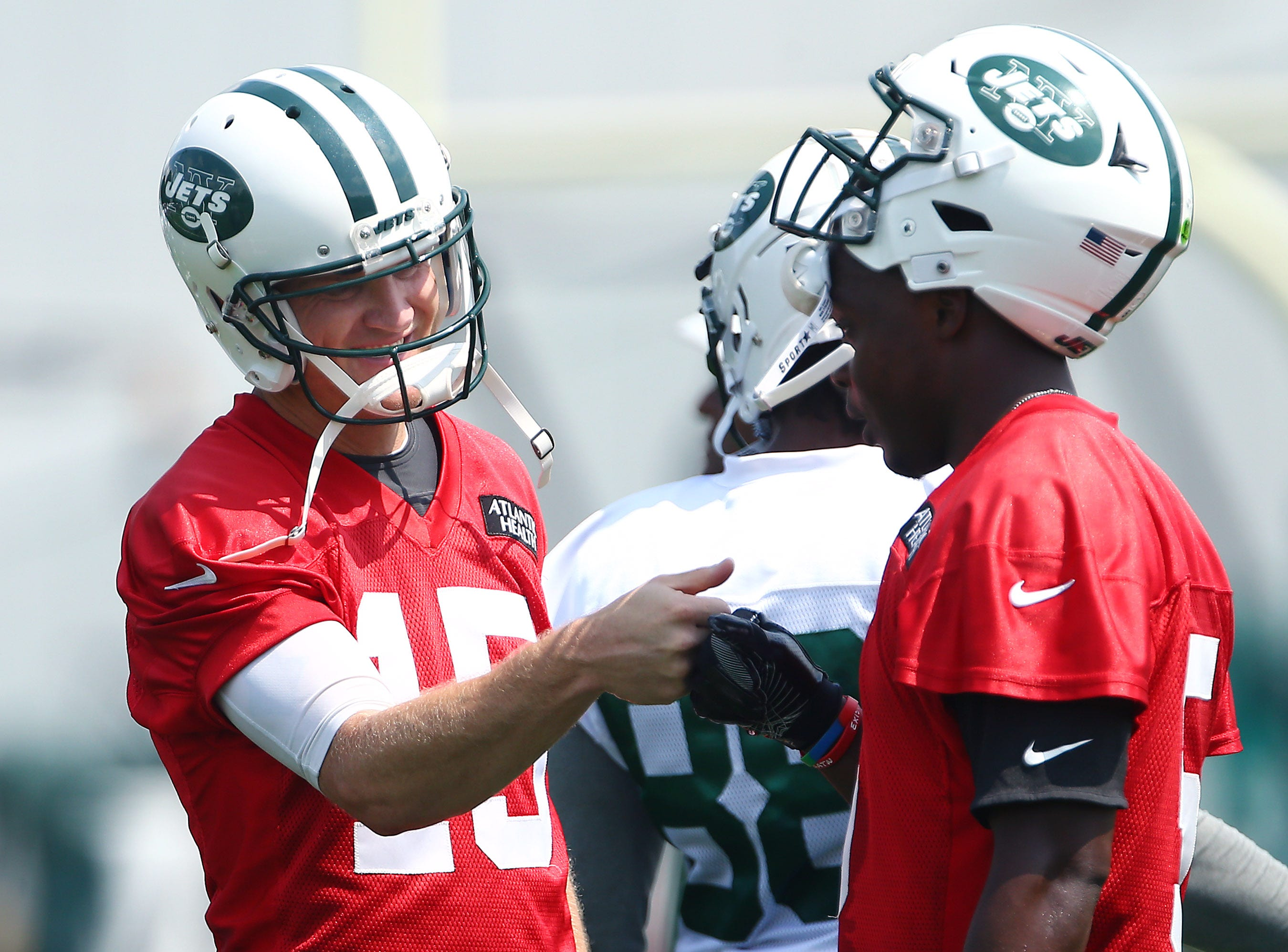 New York Jets Josh McCown gives a fist bump to fellow quarterback Teddy Bridgewater during the Jets opening day of training camp at the Atlantic Health Training Center in Florham Park. July 28, 2018. Morristown, NJ