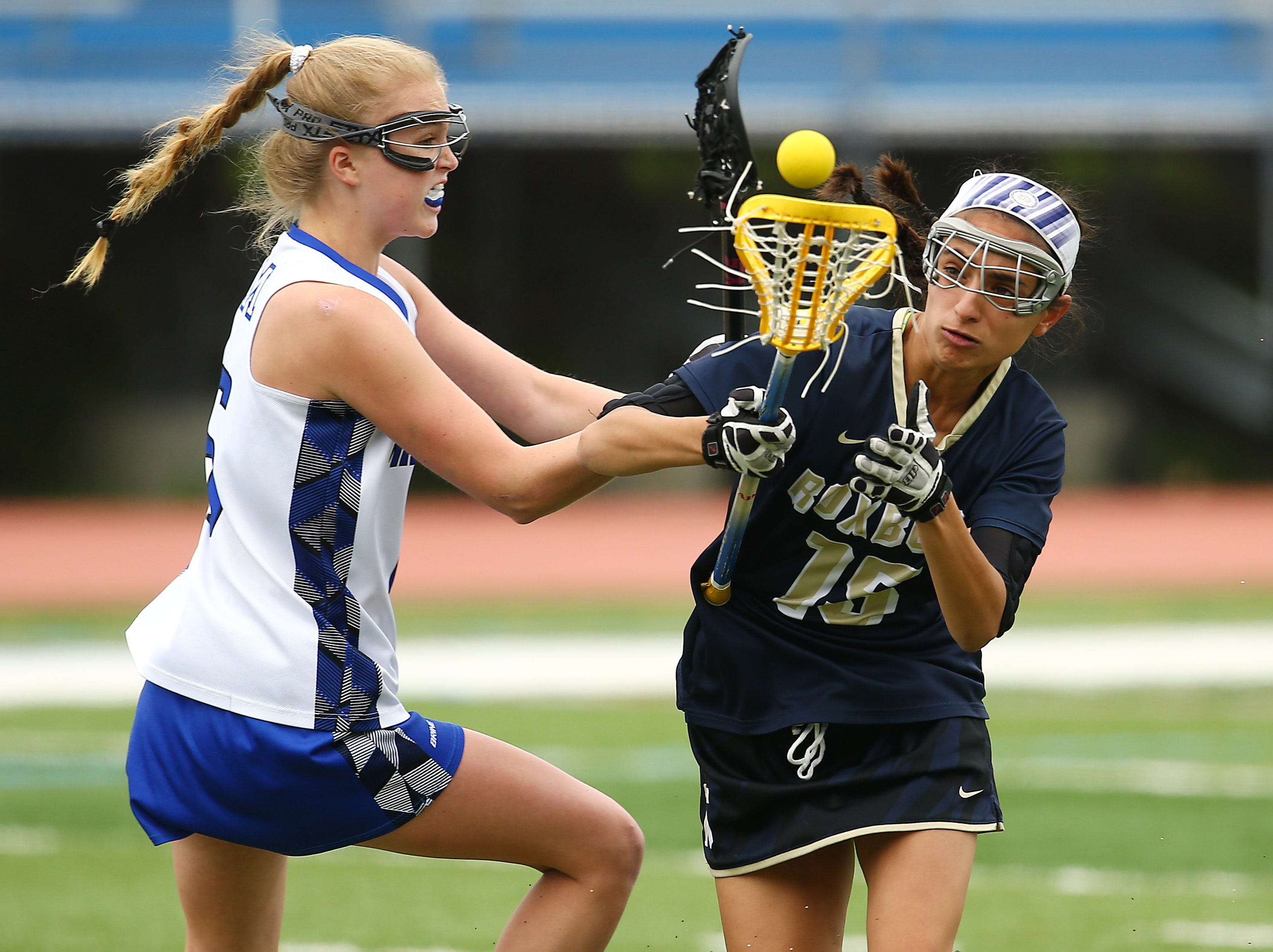 Roxbury's Emma Karnitsky is checked vs. Millburn in an NJSIAA Girls North 2 Group III second round game. May 18, 2018. Millburn, NJ