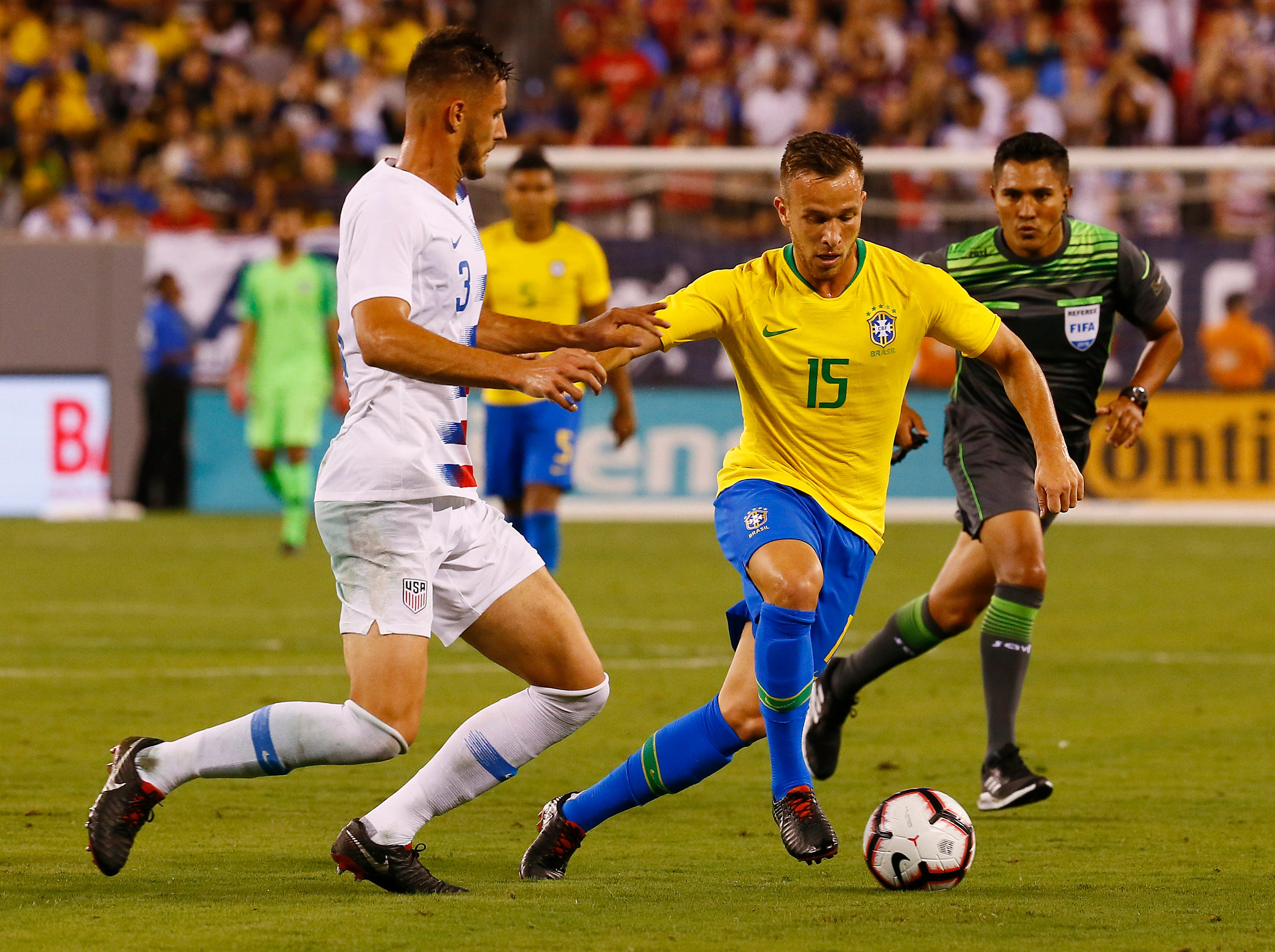 Brazil's Arthur controls the ball in front of U.S. Men's National Team's Matt Miazga during their international friendly at MetLife Stadium in East Rutherford, N.J. The US was defeated 2-0 by the five-time World Cup champions. September 7, 2018, East Rutherford, NJ