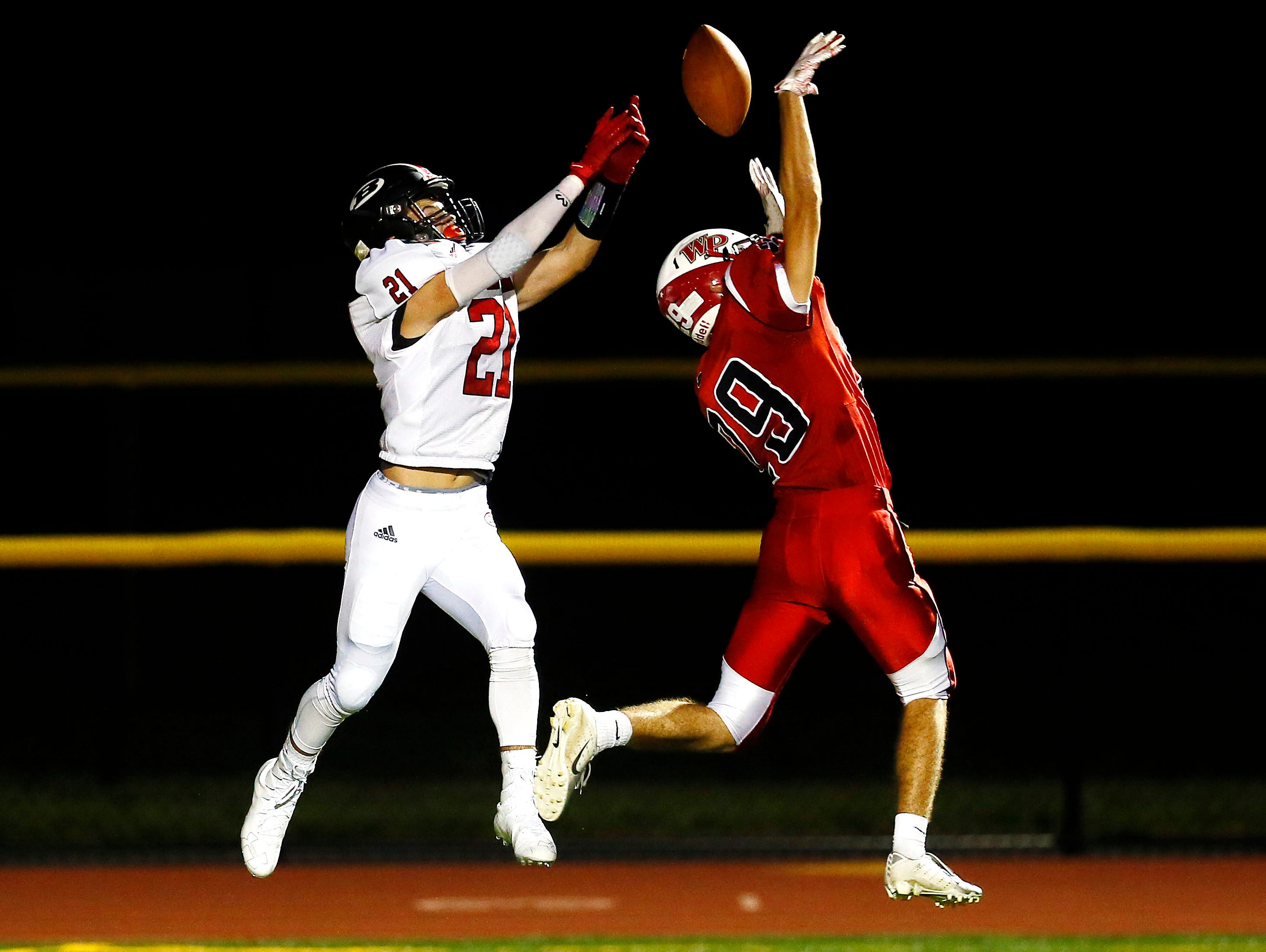 Whippany Park's Cristiano Zipeto knocks down a pass intended for Boonton receiver Nick DeLuca during their SFC American Blue Friday night football game. September 21, 2018, Whippany, NJ