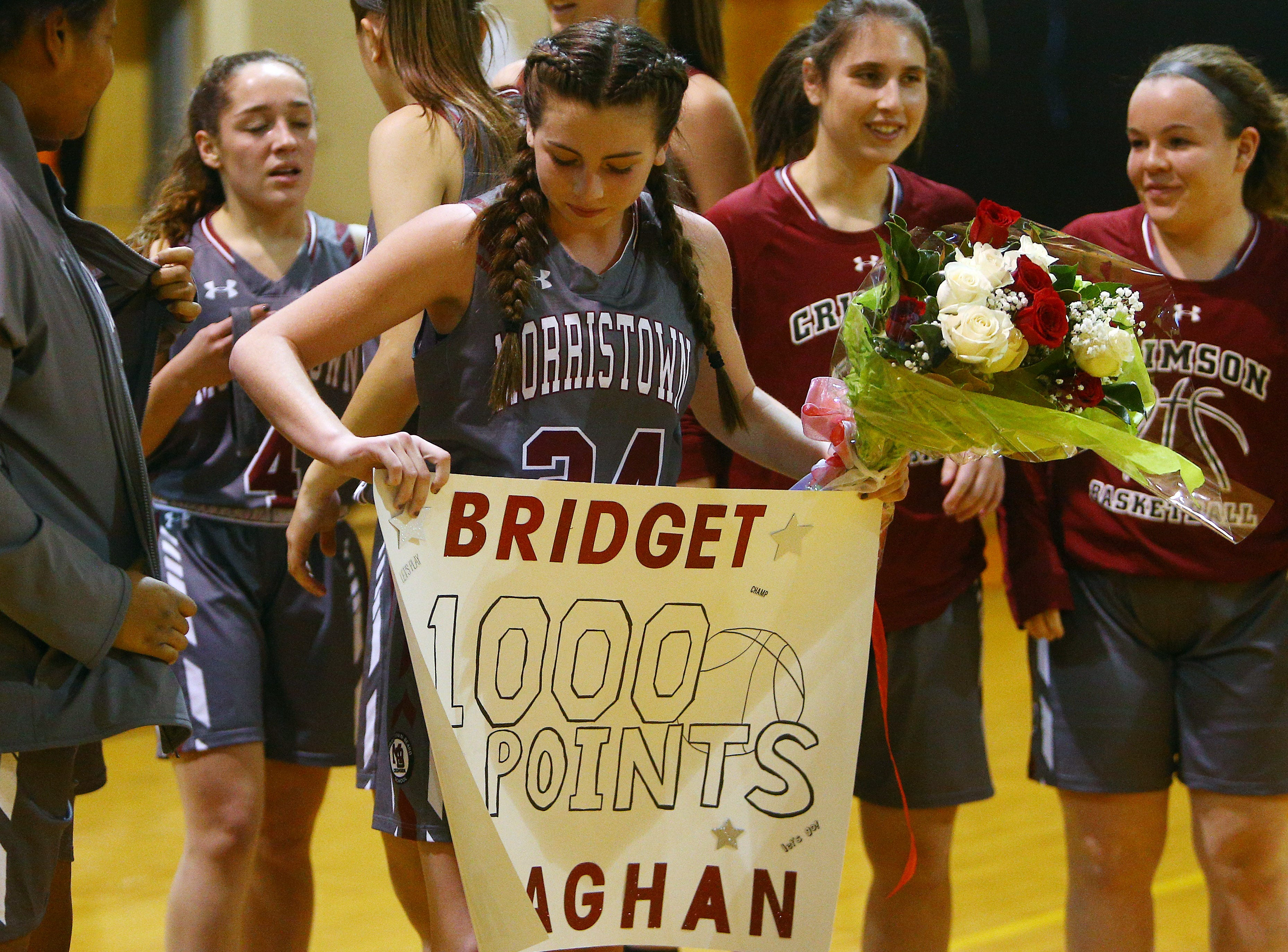 Morristown-Beard junior guard Bridget Monaghan hit her 1,000 career point for the Crimson during a NJAC-Liberty girls basketball game at Dover.  January 3, 2018. Dover, NJ.