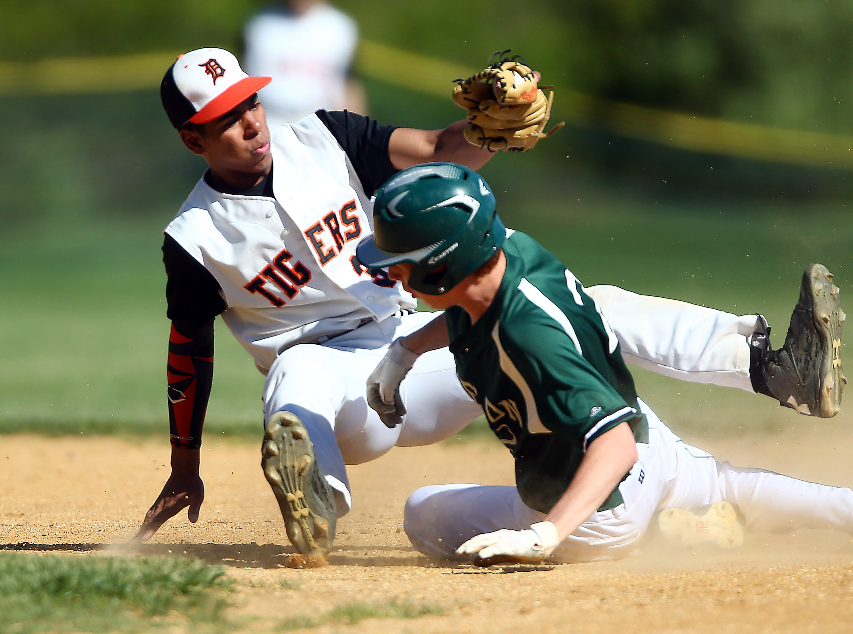 Dover shortstop Josh Blackwell tags out Kinnelon's Ben Stickle on a first inning steal. May 11, 2018. Dover, NJ