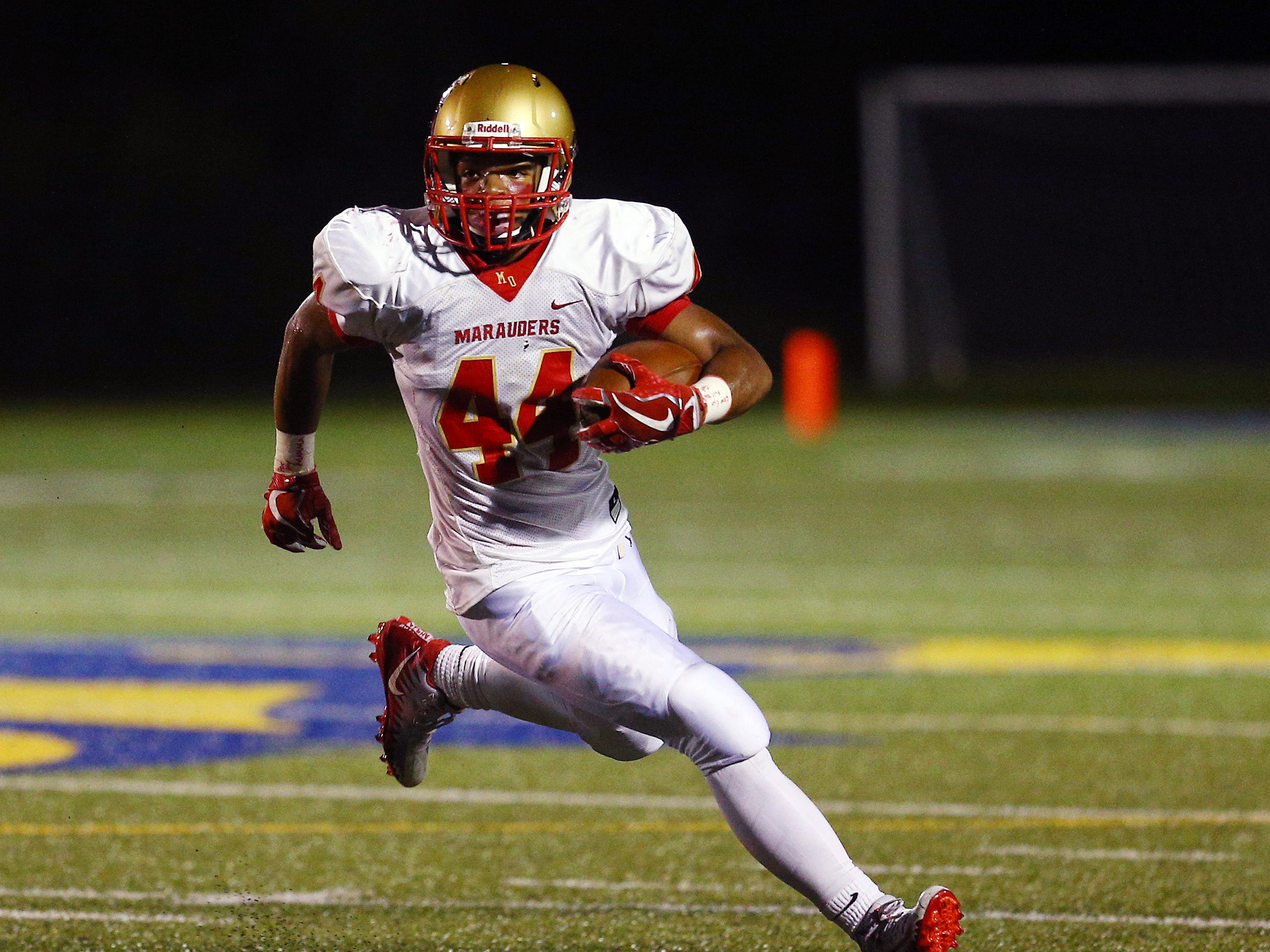 Mount Olive running back Trevon Reid gains yardage vs. Jefferson during their Friday night football game. September 14, 2018, Jefferson, NJ