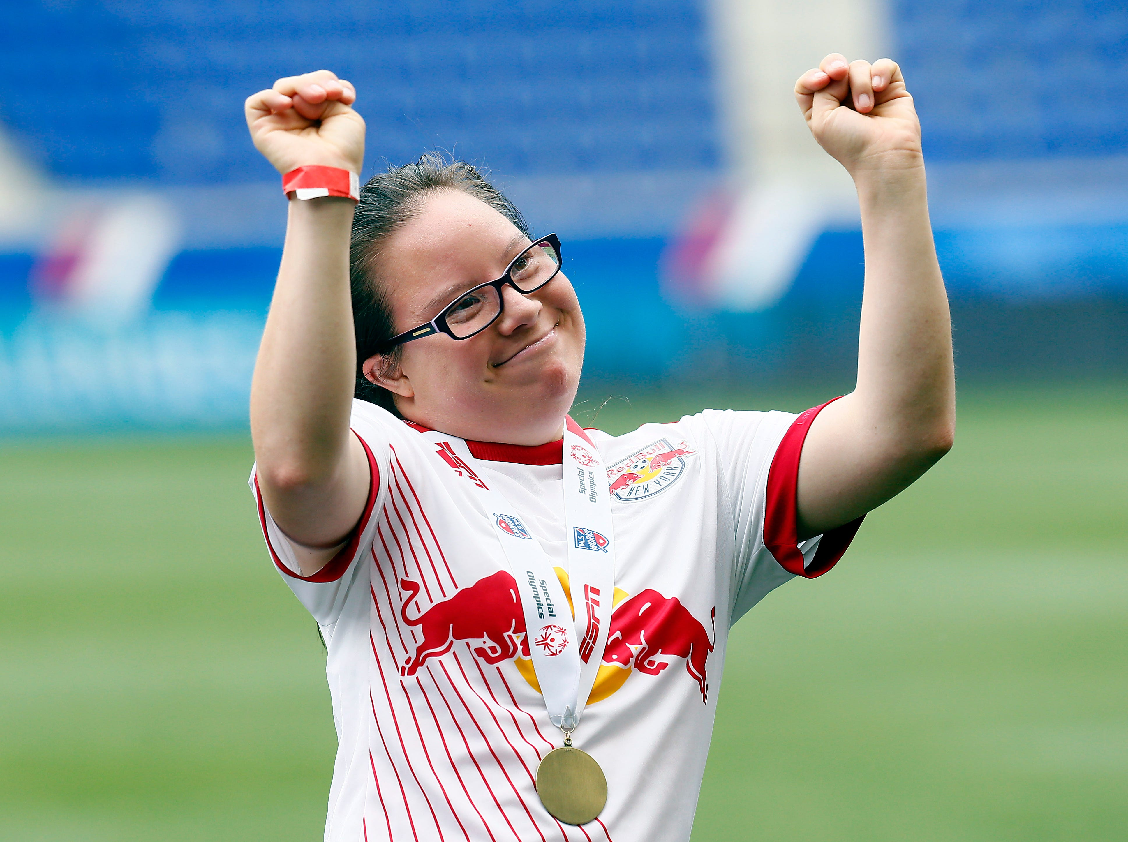 Special Olympics athlete Mai Vy Nguyen of Old Bridge playing for the Red Bulls Unified soccer team dances after receiving her medal vs. FC Dallas at the Red Bull Arena. June 23, 2018. Harrison, NJ